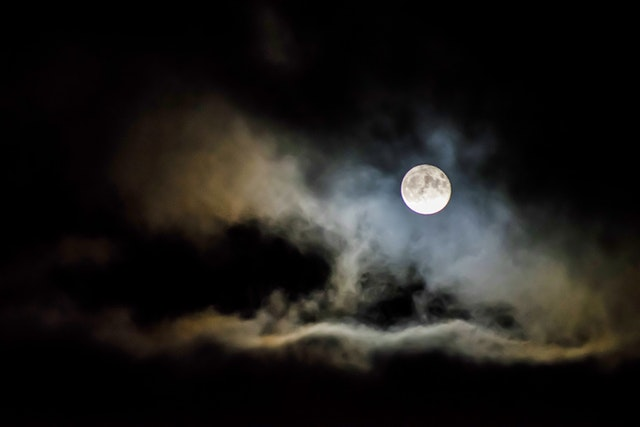 Spooky clouds with moon